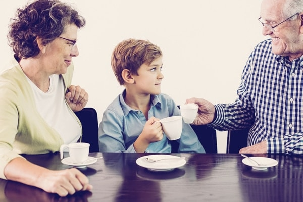 Grandson and Grandparents Drinking Hot Chocolate